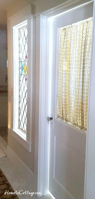 HometoCottage.com window and door let light through into bathroom