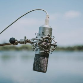 microphone suspended with lake in background