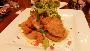 Benne Seed Buttermilk Fried Cod Filet over Grits and Fried Green Tomatoes at Miss Shirley's