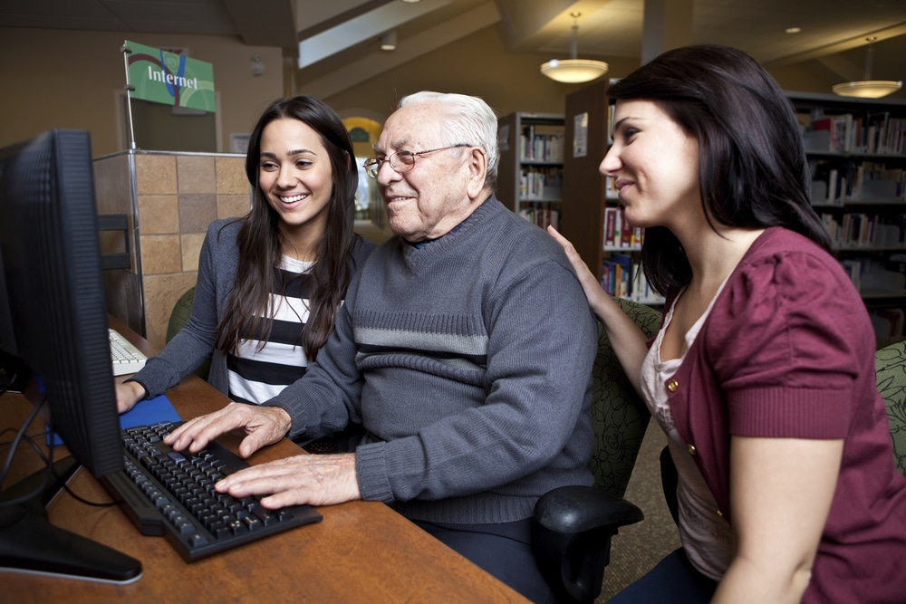 Librarians helping a man