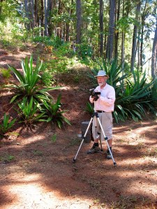 Photograph of Michael Godfrey on a trail with a tripod and camera