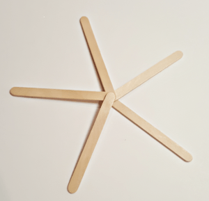 Have fun with these easy homemade Snowflake Popsicle Stick Christmas Ornaments! Share in the classroom, at home, or to go along with your Sunday school lesson. These awesome Popsicle Stick Ornaments are easy enough for any kid to make for a gift ideas or to be hung on the Christmas tree! #snowflakeornament #Christmas #diyornament