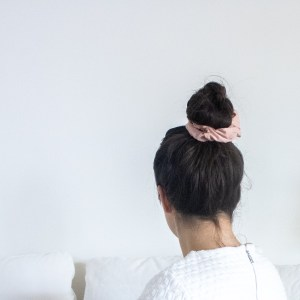 woman with pink scrunchie