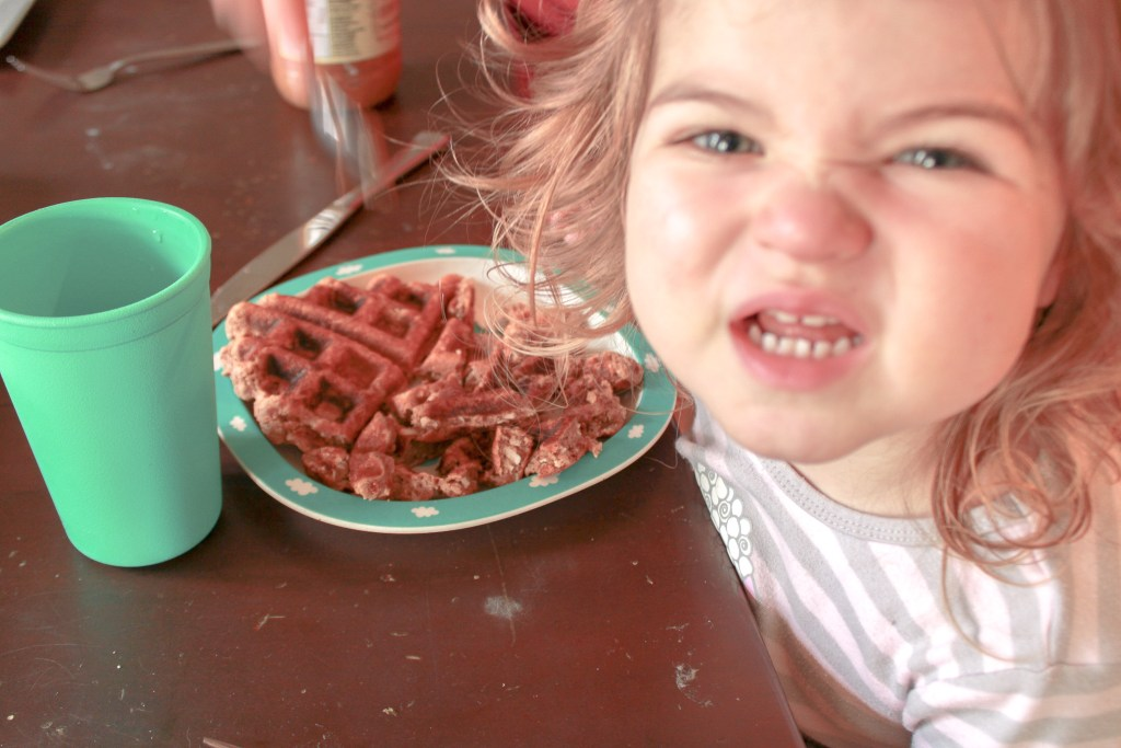 Amelia enjoying Waffles from The First Mess Cookbook