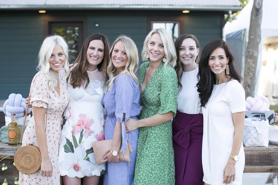 six women smiling