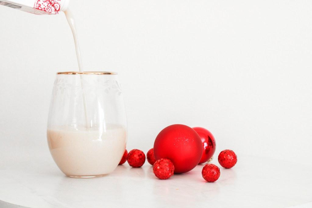 Pouring Vegan Eggnog into Gold Trim Glass