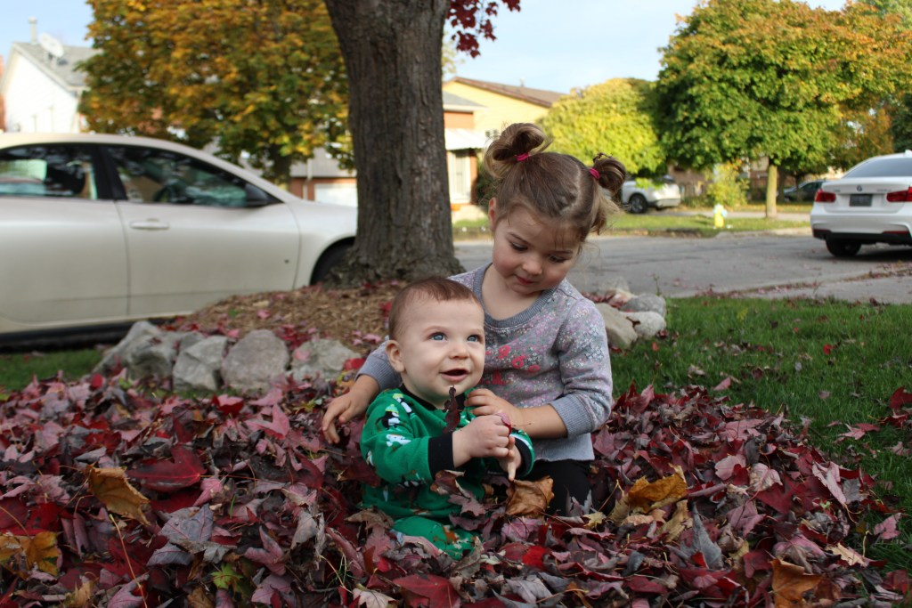 brother and sister in leaves
