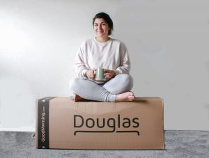 Woman Sitting on Douglas Mattress Box
