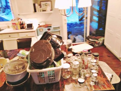 kitchen table full of items being decluttered