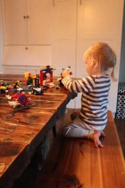 girl playing spiderman lego