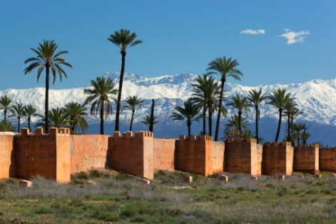 The old city walls and snow capped Atlas Mountains, Marrakech, Morocco, North Africa, Africa