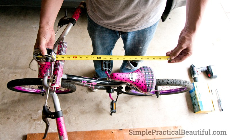 Measuring the distance between the handle bars and the rear of the seat