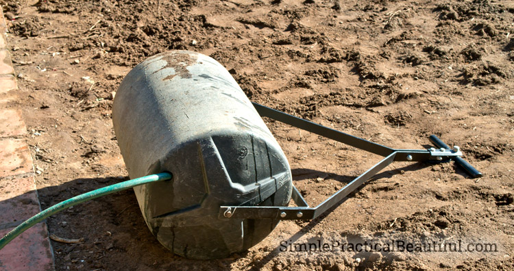 Using a lawn roller to prepare the ground for sod