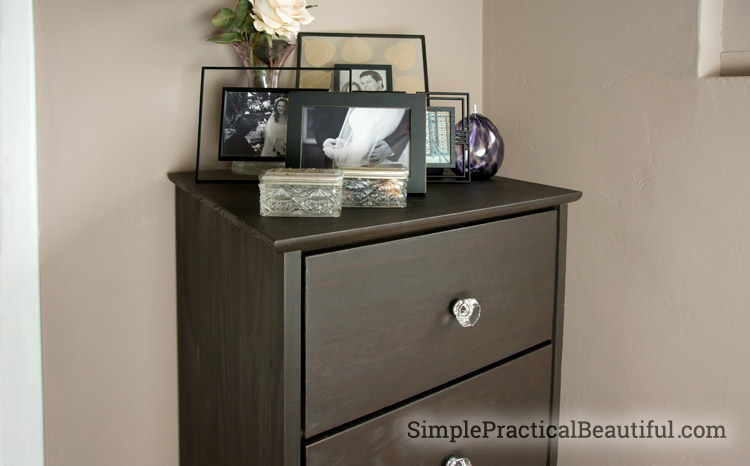 Ebony stained dresser with glass knobs