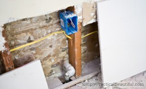 Use drywall to patch a larger hole in the wall, and attach it to the studs