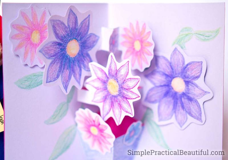 Close-up of the flowers in a handmade DIY pop-up card made with colored pencils