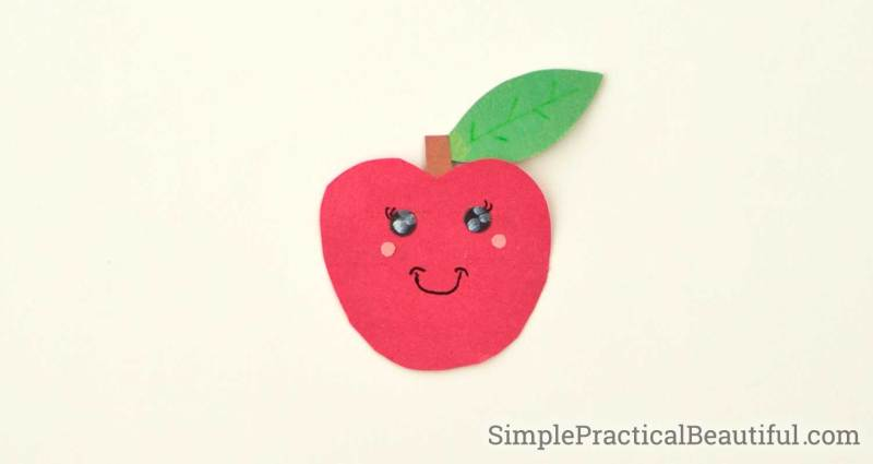 A cute paper apple character with rosy cheeks and smiling eyes
