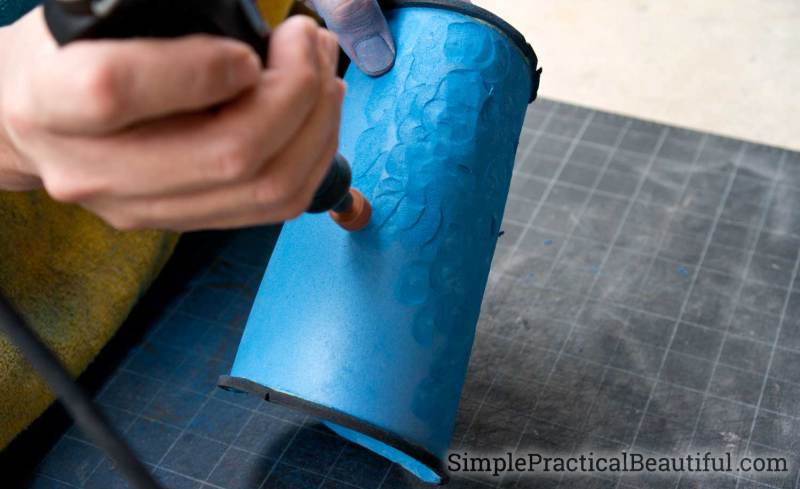 Use a rotary tool like a Dremel to make indents and divots in the foam, giving it a hammered metal look