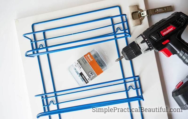 Preparing to mount a spice rack on an IKEA cabinet door