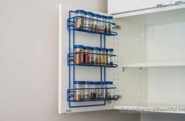 DIY spice rack on the inside of an IKEA cabinet door
