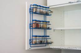 DIY spice rack on the inside of an IKEA cabinet door