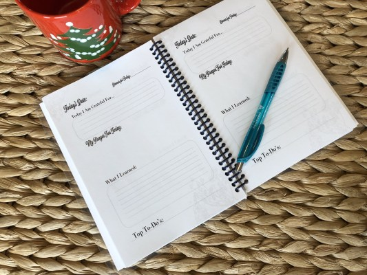 daily journal with Christmas cup