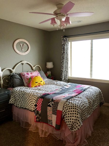 queen bed in girls grey and pink bedroom