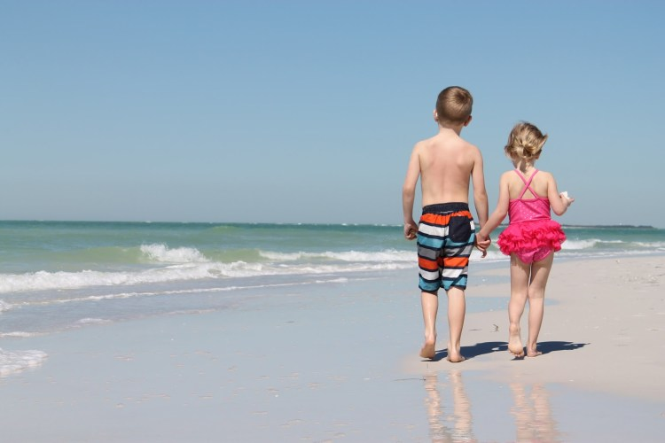 kids holding hands on Anna Maria Island