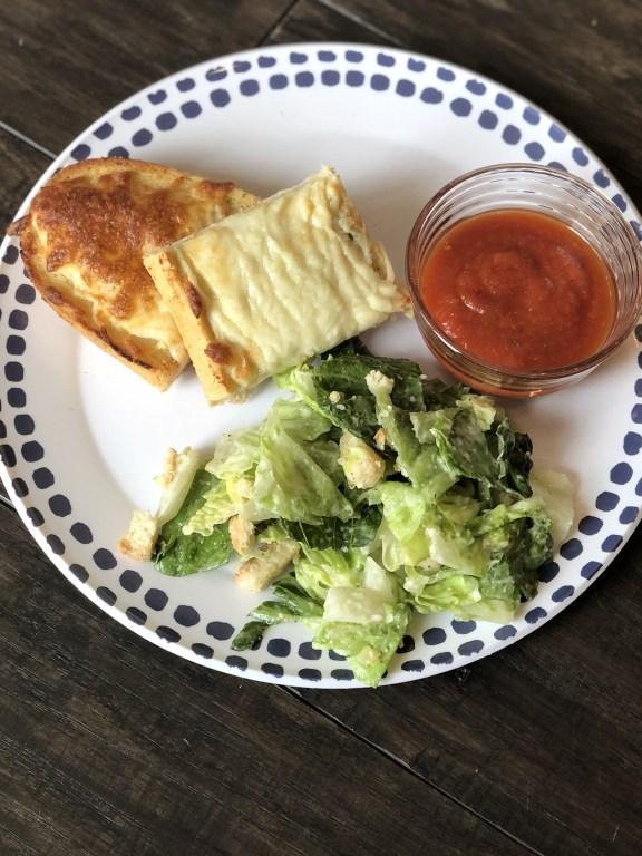 Cheesy garlic bread pizza with salad