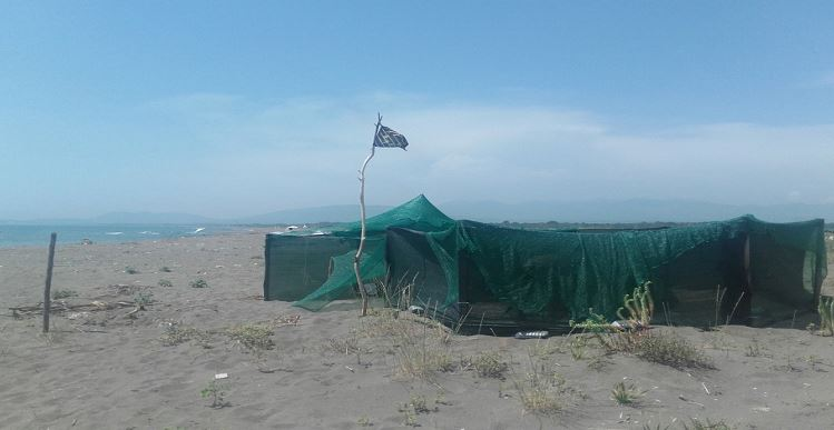 tents surroundend by tarps for wind protection