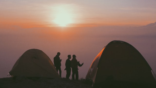 camping in a tall tent at sundown