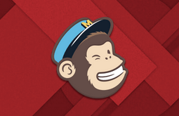 MailChimp winking monkey icon on red background