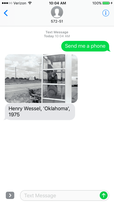 iPhone screenshot showing a 1975 Henry Wessel artwork of an Oklahoma woman standing in a phone booth by a road