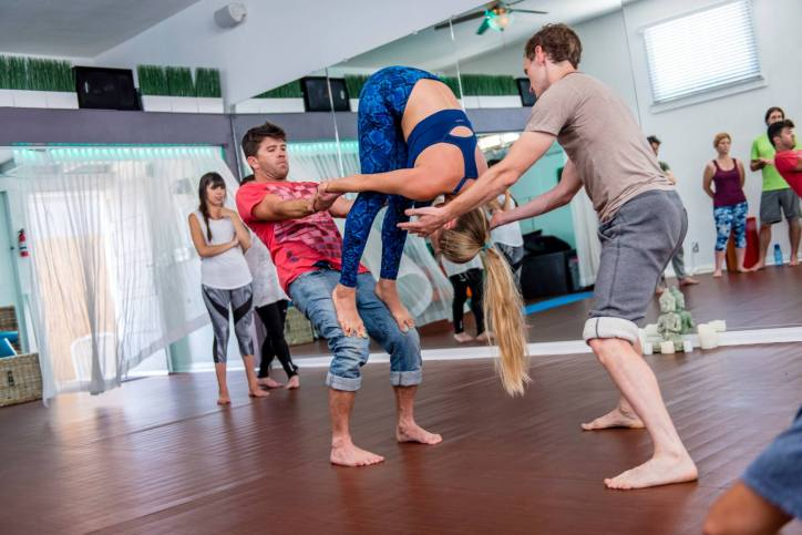 Standing Forward Fold Counter Balance at Veda Yoga Center