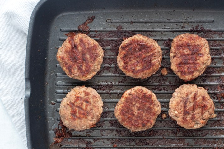 sliders cooking in skillet