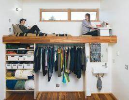 "A pair of windows shed a bit of light in the Harpoon House bedroom, which boasts a lofted bed and workspace with a sink and closet beneath. The sink is by Lacava and the tap is from Fluid Faucet's Wisdom line. ""People ask us, 'What did you do to make your house not feel like this cramped little thing?' with the idea that the house is trying to act big,"" says resident Katherine Bovee. ""It's not. It's a small house acting like a small house. We built the house to fit in its own skin."" Photo by John Clark"