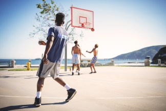 People playing basketball outside