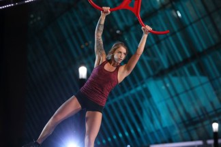 A woman competing in American Ninja Warrior