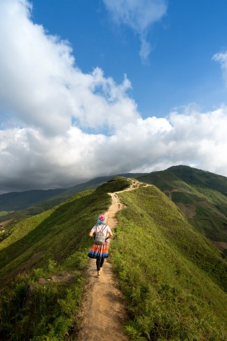 A girl hikes a beautiful mountain-top path