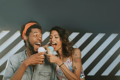A man and a woman eating ice cream