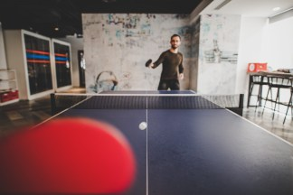 A man playing table tennis indoor