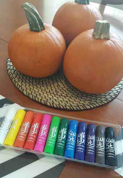 3 pumpkins with kwik stix solid tempera paints to be used to paint a no carve pumpkin