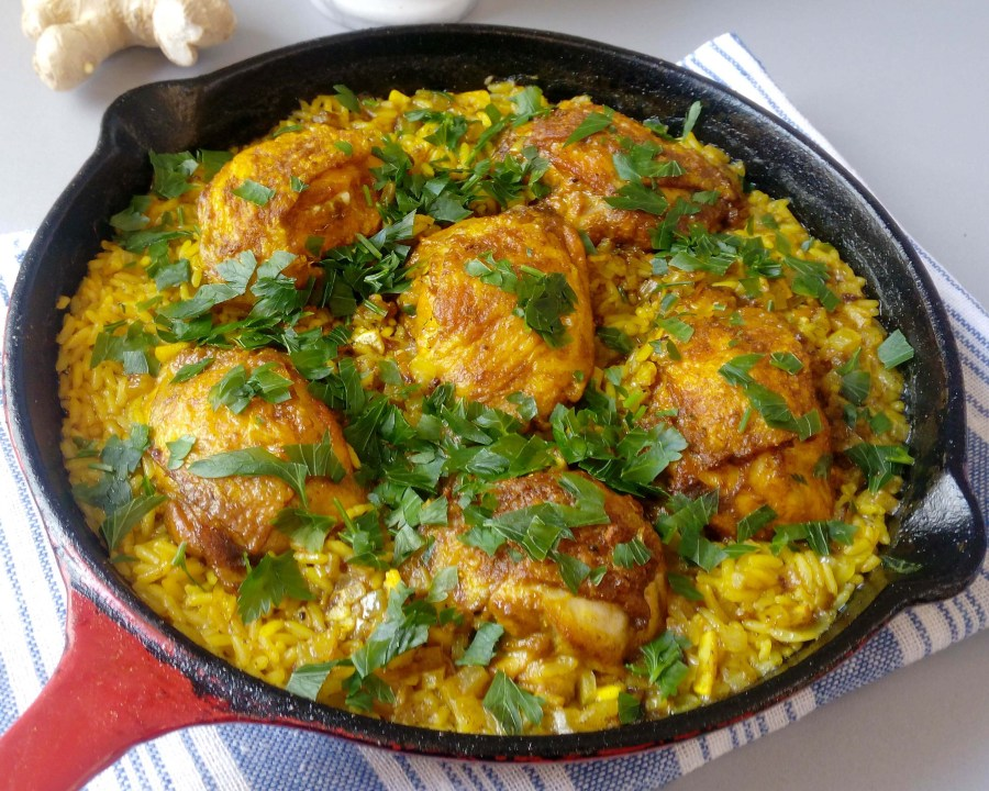 Looking for some cheap and quick recipe to make for your family? This one-skillet ginger and turmeric chicken thighs are the perfect option for busy days and lazy weeknights. My whole family really loves this dish, and yours will too! Try it now! | #onepanrecipe #onepanchickenthighs #chickenthighsandrice | simplyanchy.com