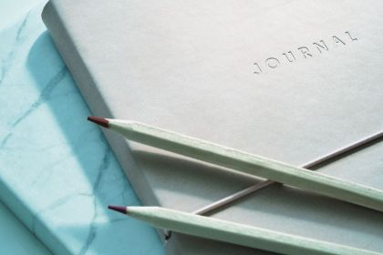 journal and pencils
