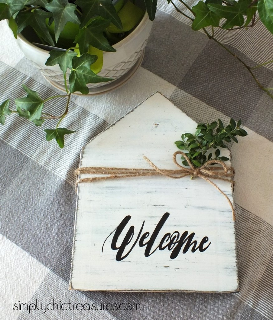 distressed white house shaped sign handpainted