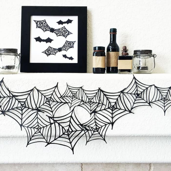 Cut Paper Spider Web Garland by Jen Goode of 100 Directions