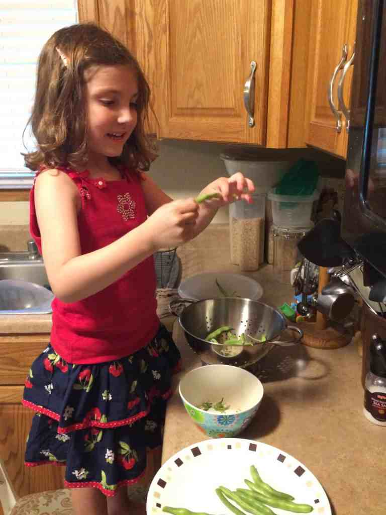 My daughter snapping green beans