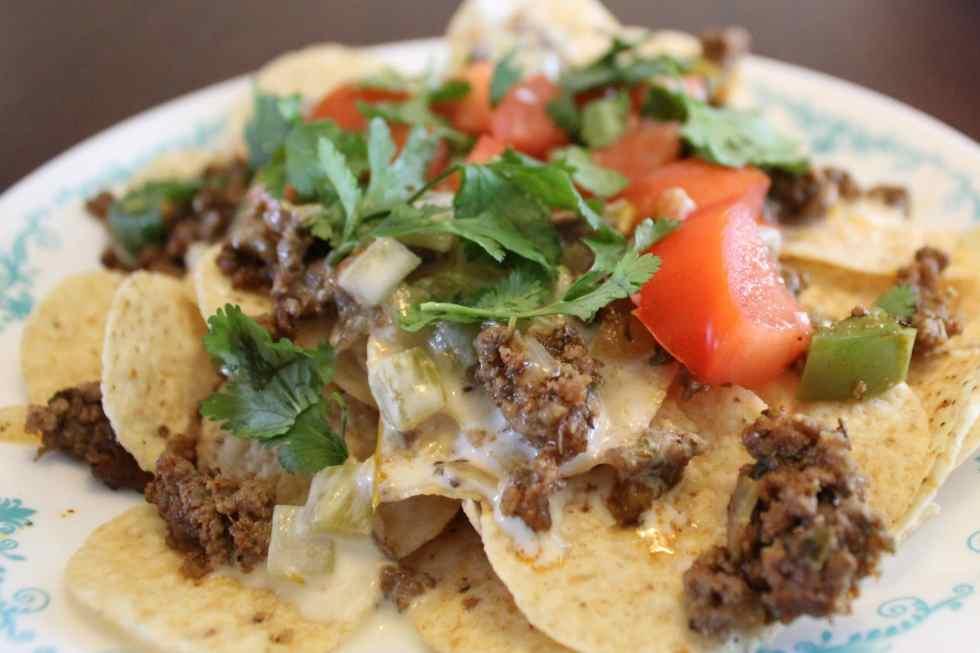 Taco Nachos with Beef, White Queso, Tomato, and Cilantro