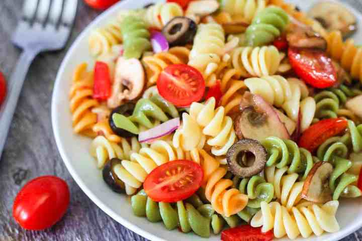 Serve our Tri Color Pasta Salad loaded with vegetables as a great side dish or complete meal alongside your favorite grilled meat or protein.
