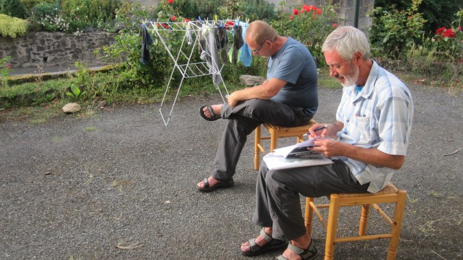 Rohan and Eddy writing the diary in front of the refuge